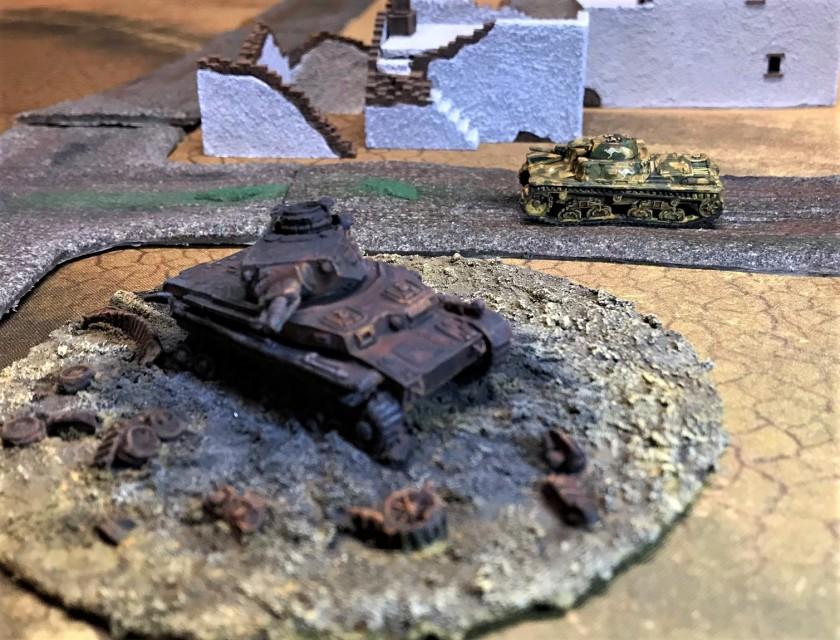 8 Australian M11 39 drives by Panzer IV wreck