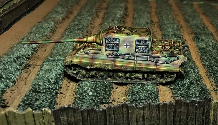 12 Jagdtiger hiding in field, left side
