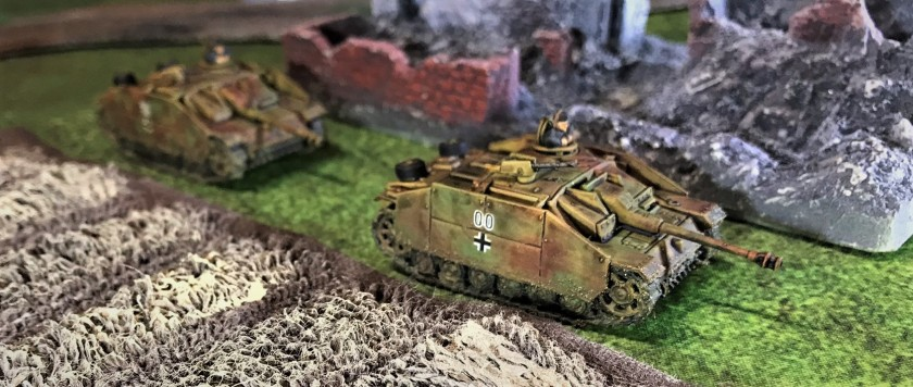 2 Stug G's by wrecked building