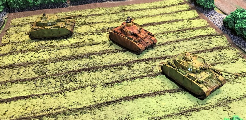 4 all 3 Panzer IV H's in a field