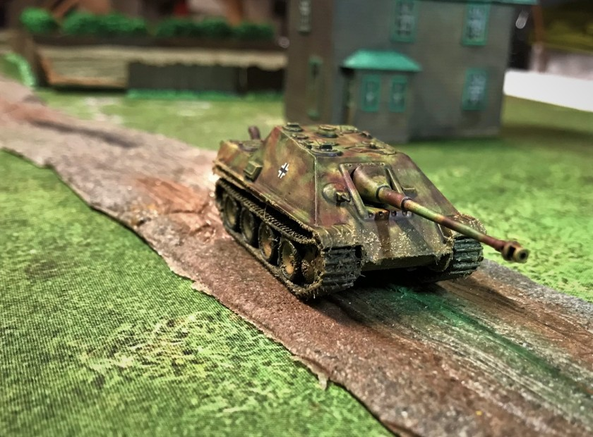 4 Jagdpanther moving down road, frontal view
