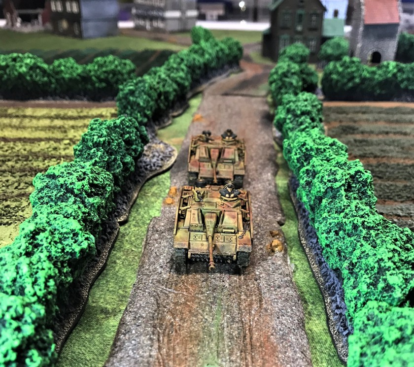 4 Stug G's advancing down road