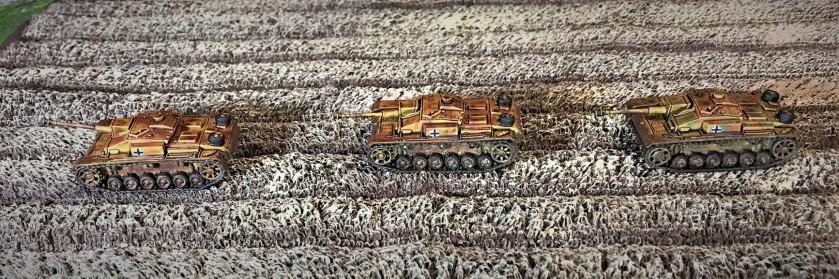 5 StuG F8's in wheat field left side view