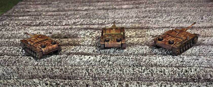 6 StuG F8's in wheat field rear view
