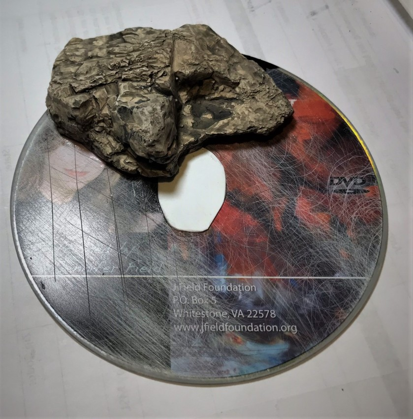 2 cd and stone and card