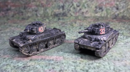 Both Panzer 38(t) models, front left side.