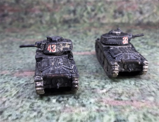 Both Panzer 38(t) models, rear view.